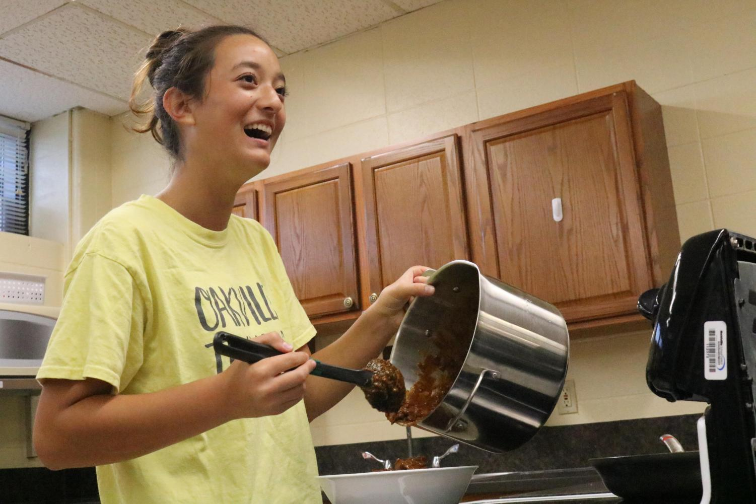 Megan Blanchard (10) prepares toppings for baked potatoes for the first Tiger Takeout on Oct. 4.