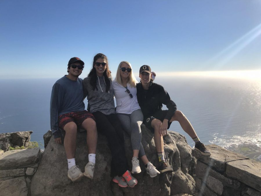 Sam Gandhi (12), Mrs. Samantha Bhambri, and former OHS students Claire Sedlack and Carson King enjoy their experience in South Africa.