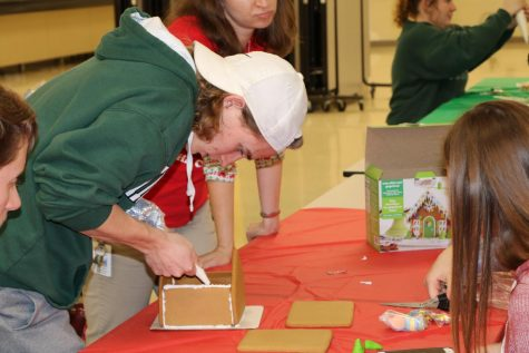 Winner Nathan Long (12), focusing on building his gingerbread house.