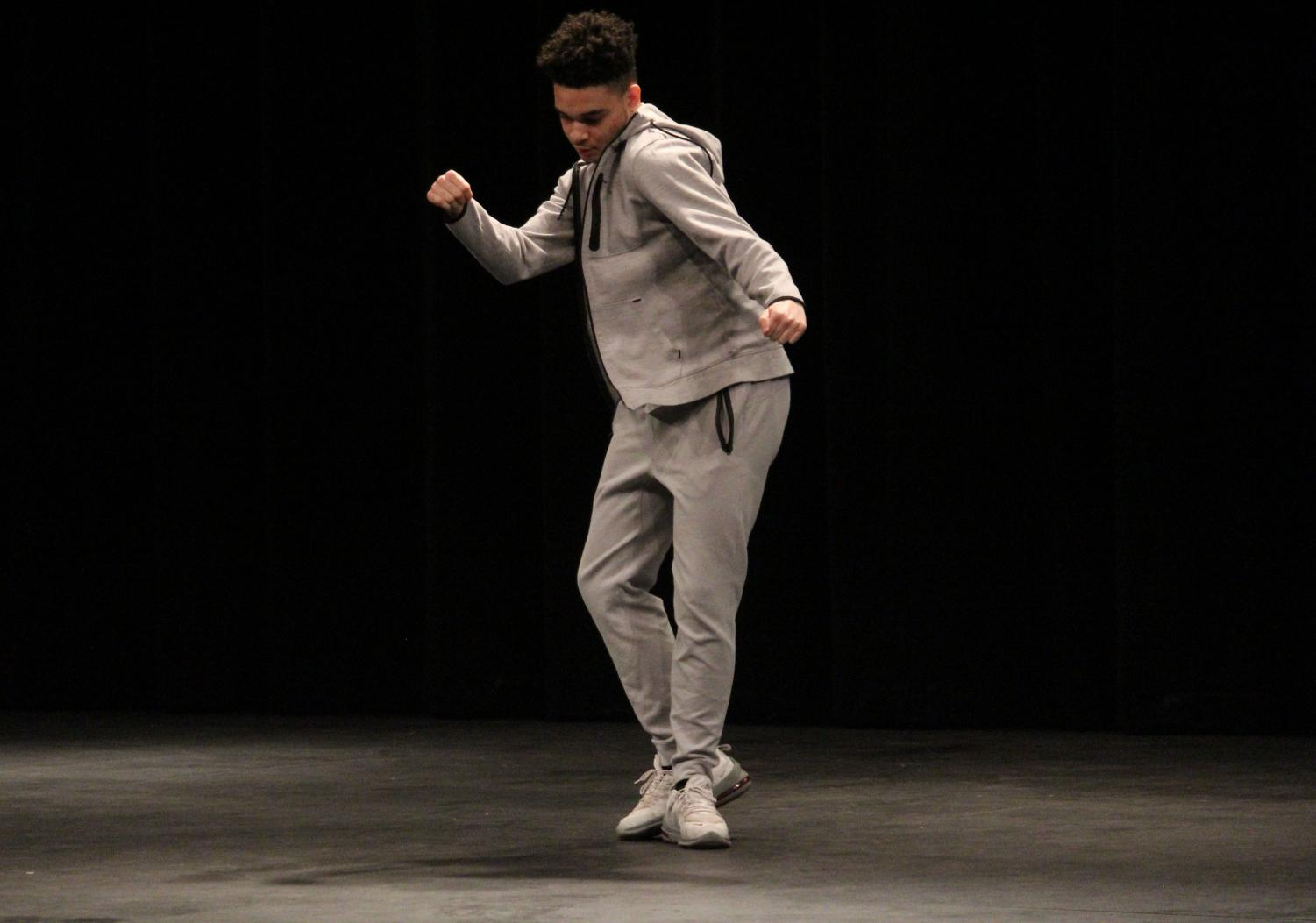Bryant Igwe (12) shows off his dancing skills on the stage.