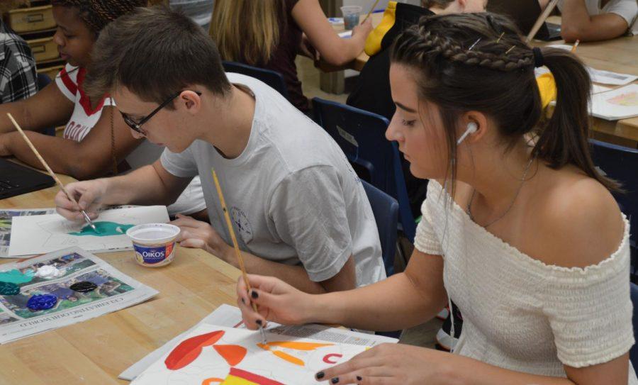 Jared Goewert (12) and Hannah Jones (12) paint during their art class.