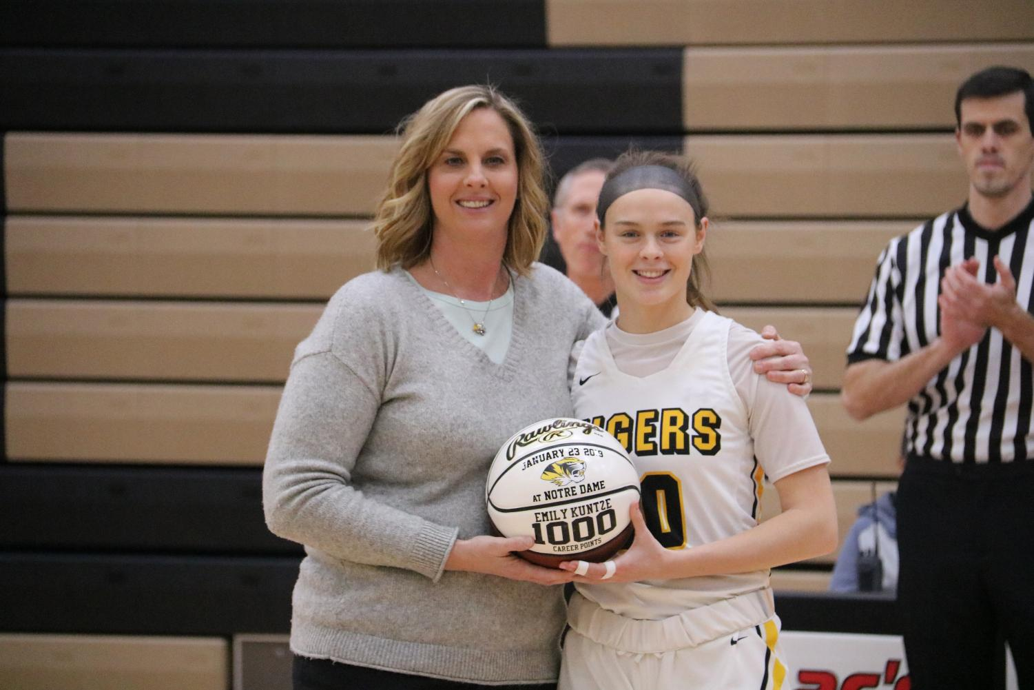 Emily Kuntze proudly displaying her 1000 point ball.