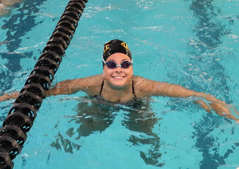 Allison Streb (12) smiles during swim practice.