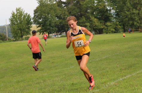 MacKenzie Montandon (11) finishing a race.