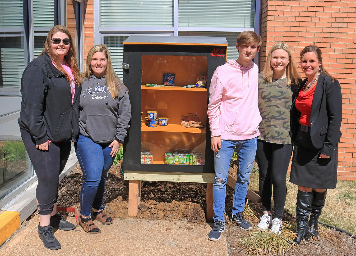 FCCLA students standing next to the new food locker at Trautwein Elementary.