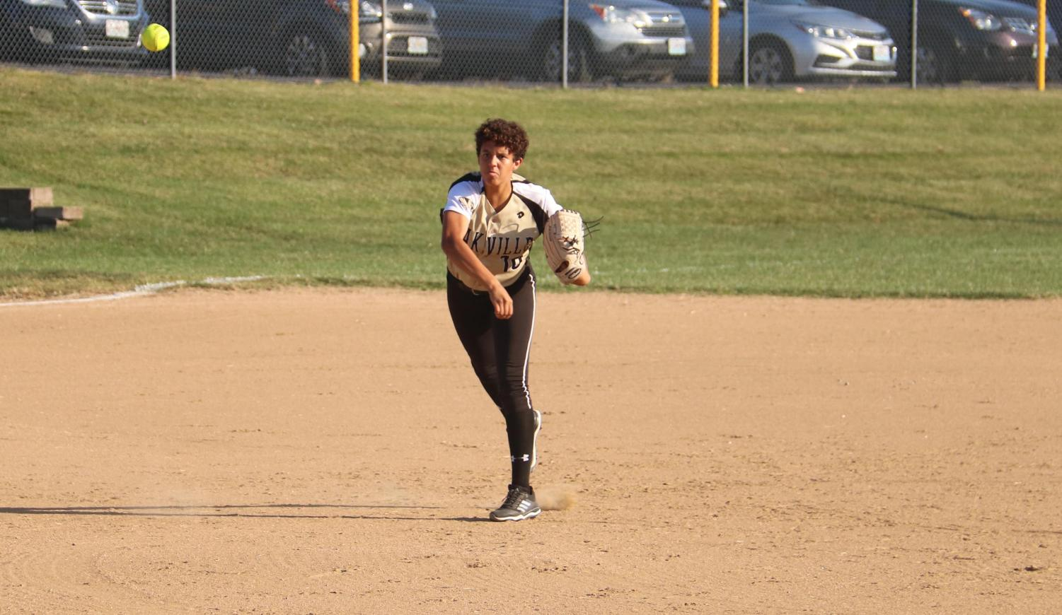 Ella Strickland (10) tries to get the out.
