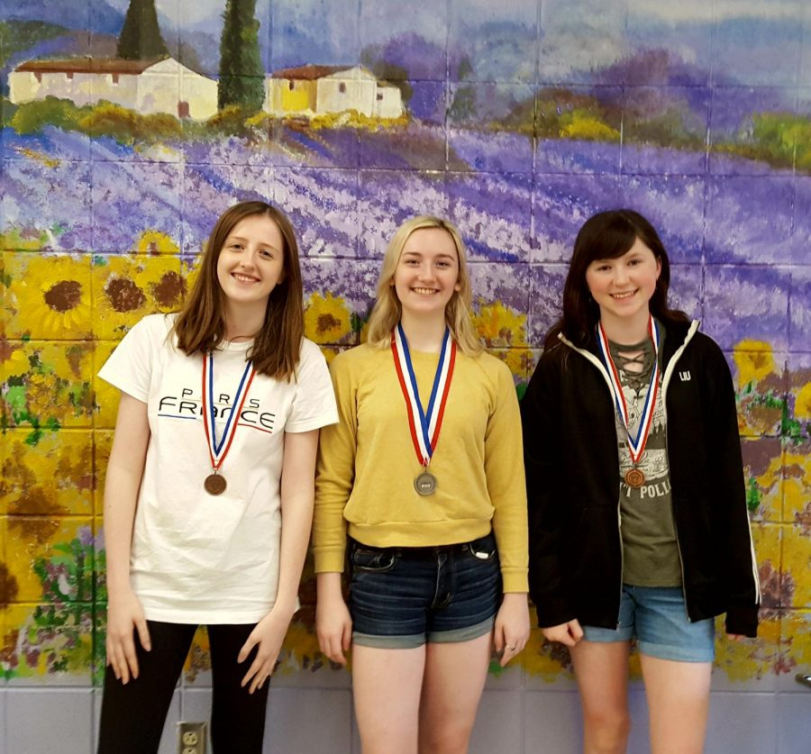 Kathleen Seithel (10), Kirsten Kauffman (12), and Eleanore West (9) place in the National French Exam.