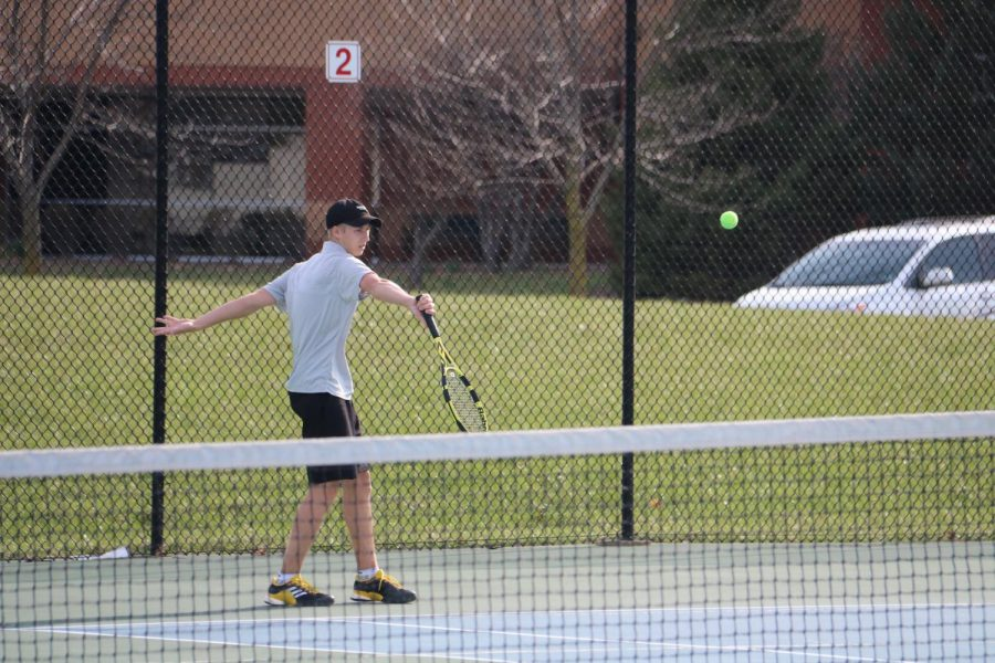 David Cormack (12) hits the ball at a tennis match at Bernard Middle School.
