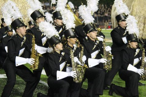 "The alto-saxophone section performs during the 2018 show, ""Bottled Up,"" during a home football game."