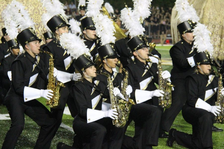 The+alto-saxophone+section+performs+during+the+2018+show%2C+%22Bottled+Up%2C%22+during+a+home+football+game.
