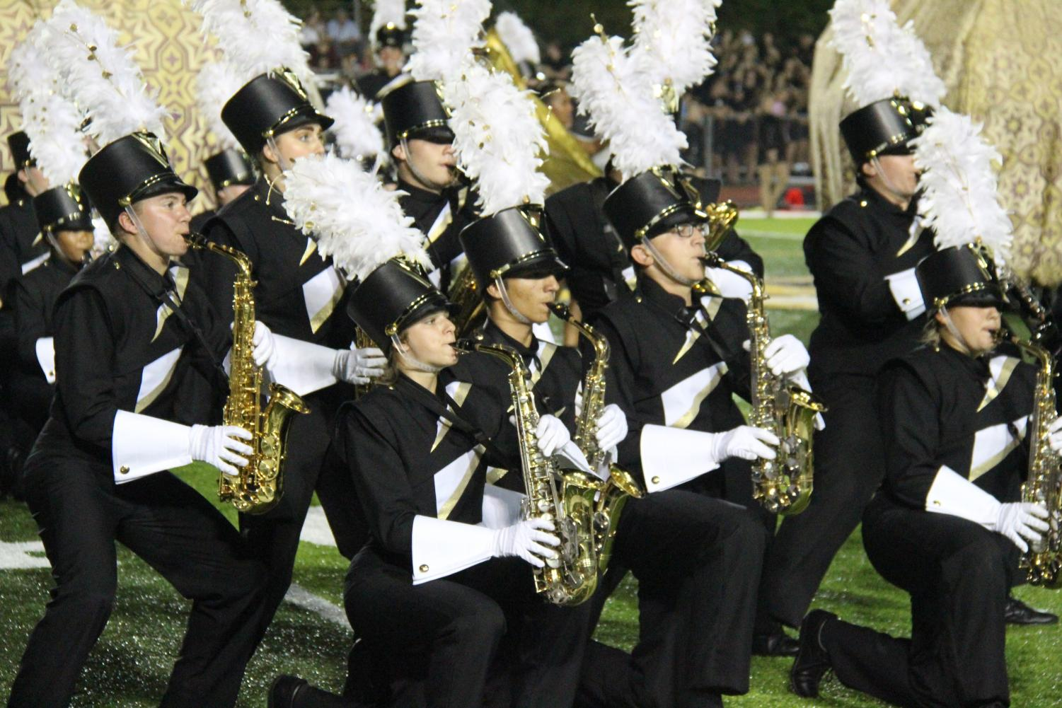 The alto-saxophone section performs during the 2018 show,