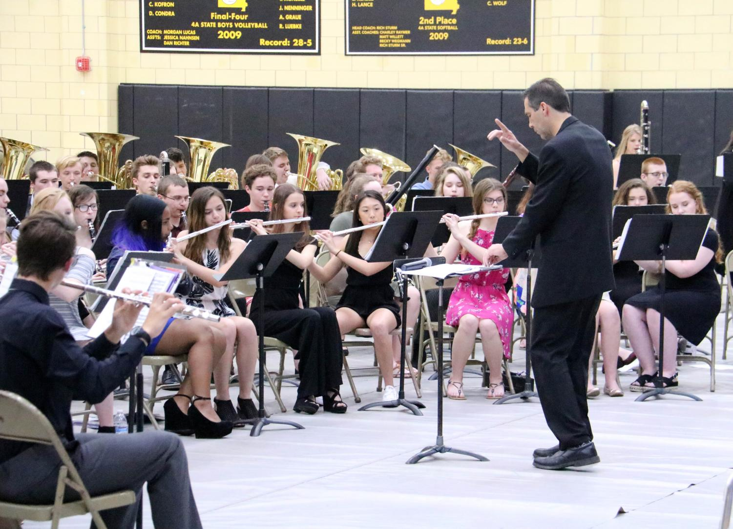 Head band director Mr. Vance Brakefield conducts the band at the senior farewell concert on May 8.