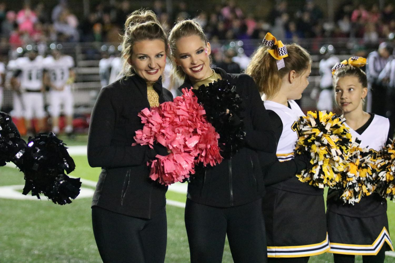 Morgan Murphy (12) and Carolyn Grayson (12) pose together at a home football game.