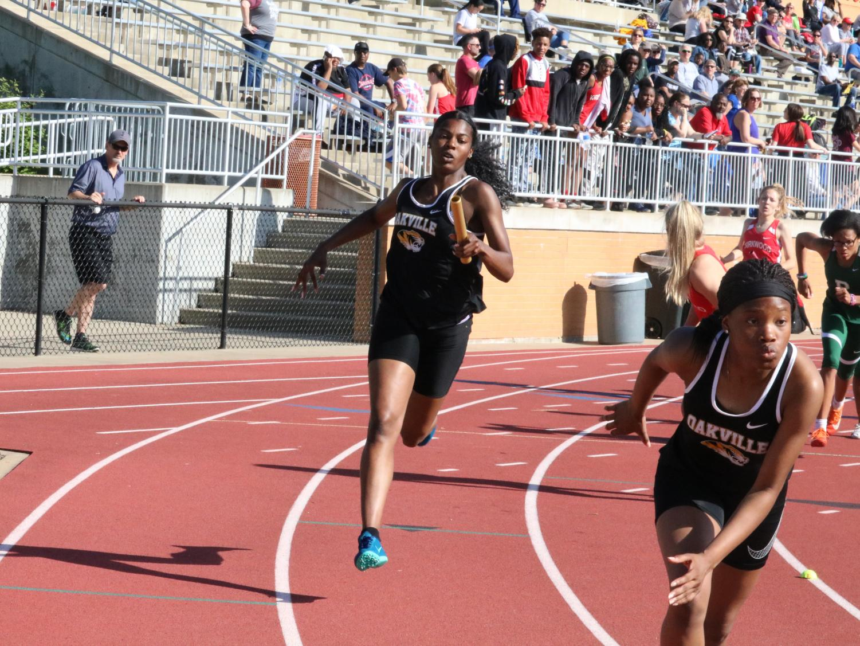 Kiya Conners (12) and Miya Minor (9) on the track.