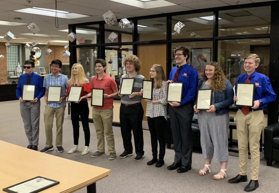 TSA students receive their awards in the OHS library.