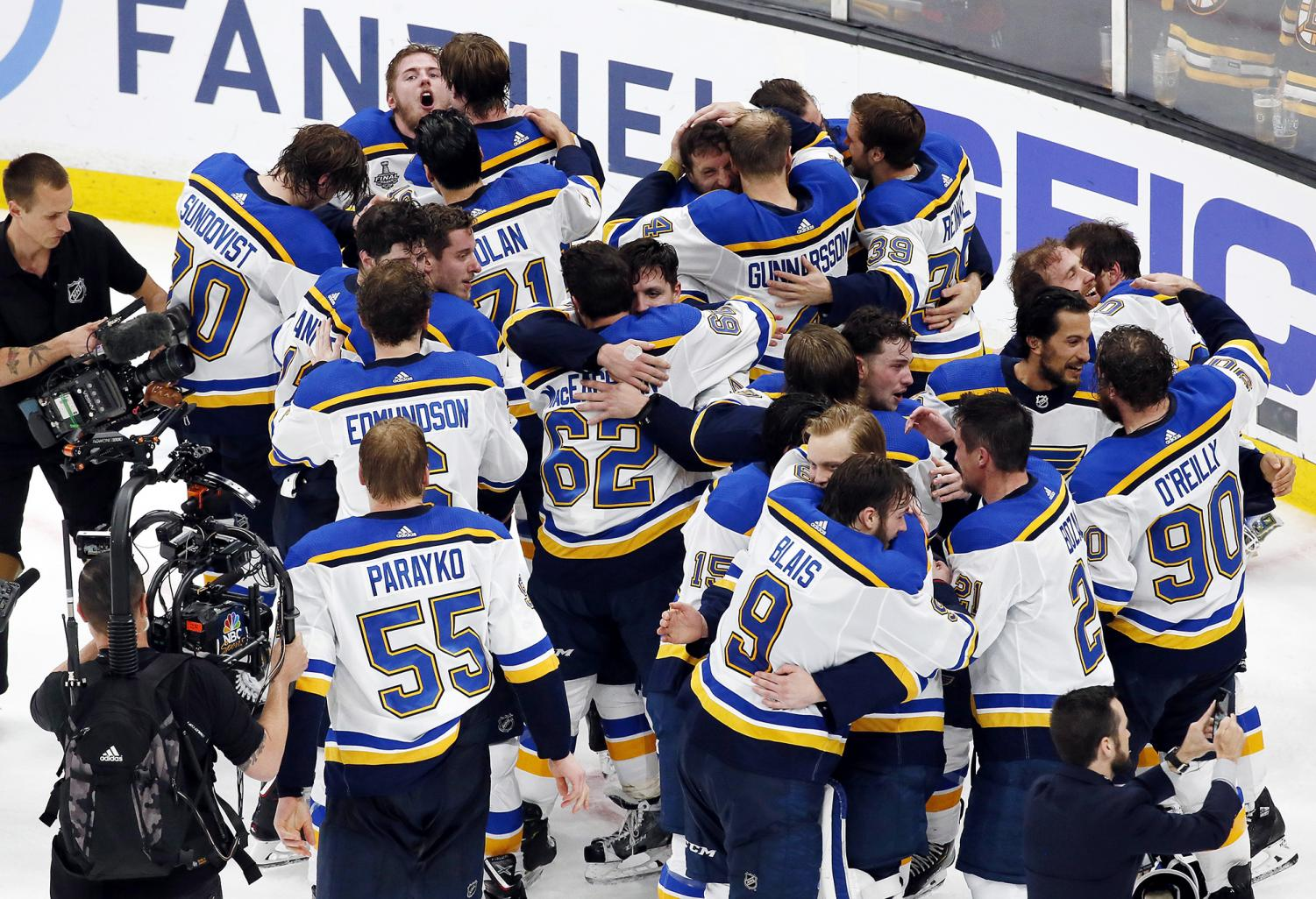 St. Louis Blues exchange hugs as they are named Stanley Cup Champions.