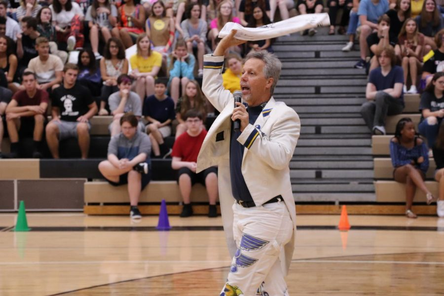 Ron Baechle OHS (class of 1977) also known as the Blues Towel Man getting ready to throw towels to the students in the back-toschool assembly