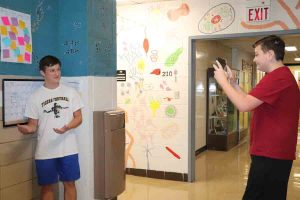 Thomas Caira (10) and Seth Freshman (10) get out of the class room for a new scavenger hunt activity