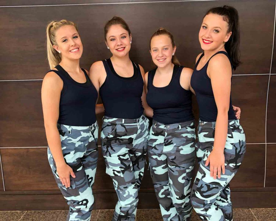 Hannah Phelps (12), Taylor Phelps (9), Rylee Brawley (9), and Taylor Herrmann (11), pose before awards at National Baton Twirling Association's USA/World Championship Competition