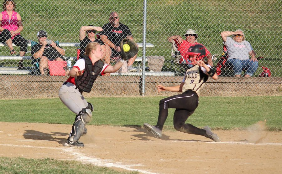 Amanda FitzWilliam slides  into home, scoring the game winning run.