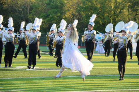 Courtney Kreyling (9) flies through the performance at Friday
