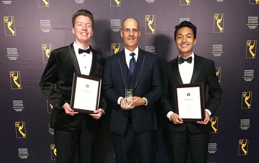 Caden Turner, Jeff Kuchno, and Louis Luong stand on the red carpet with their awards.
