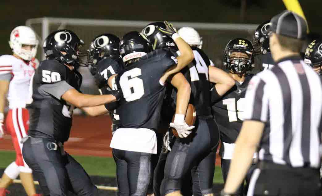 Chase Otto getting congratulated on Oakville's first touchdown this season.