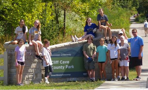 Eco-Art club poses for a picture the day of the Cliff Cave clean up.
