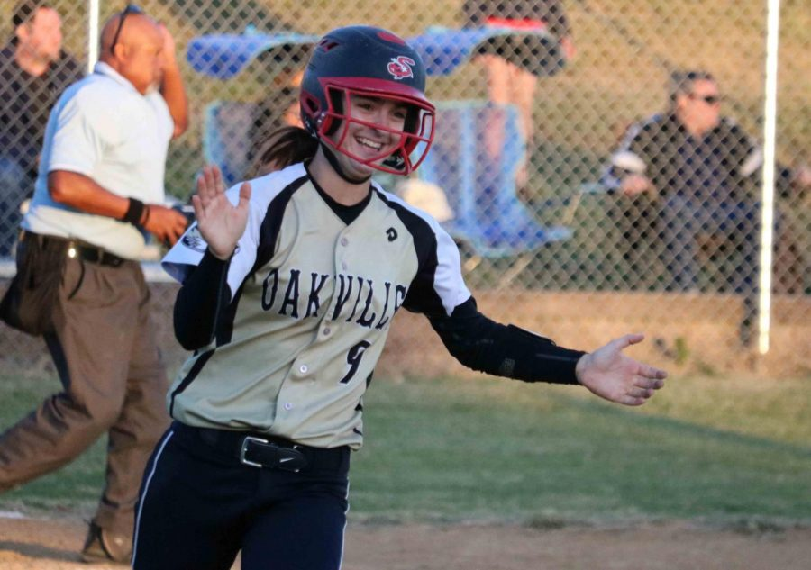 Amanda FitzWilliam celebrates as she hits walk-off, game winning home run, agains Cor Jesu.