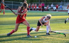Field hockey adapts to playing on home turf for first time