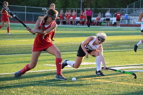 Emma Rose Seger (11) defends the ball before it gets to the goal.