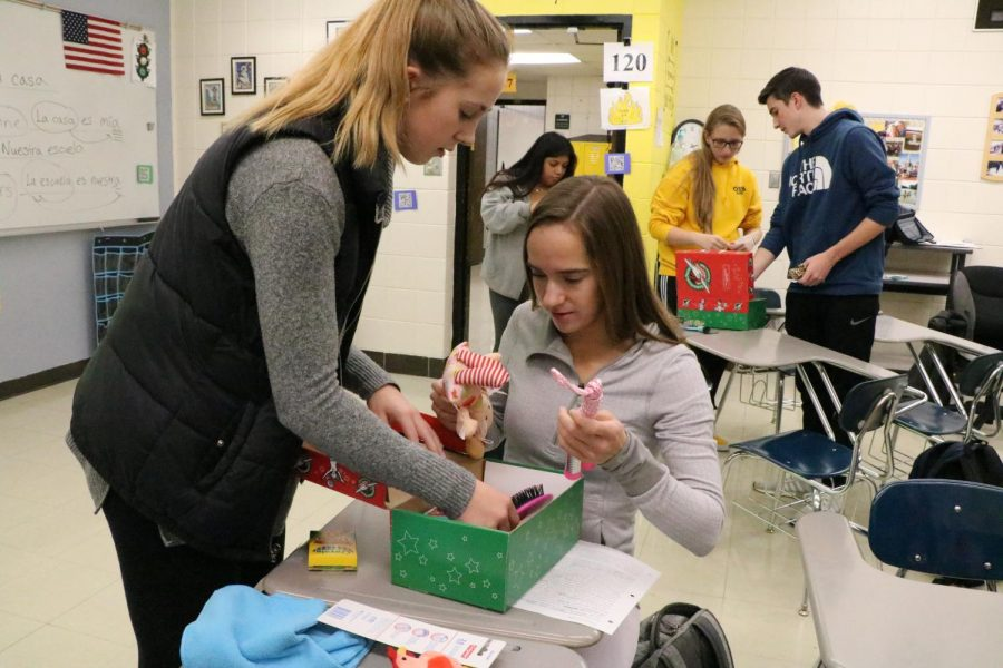 Maddie Brutton (12) and Kayla FitzWilliam (12)  wrap a gift for children in  Central and South America.
