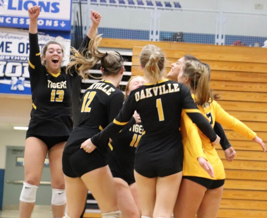 Girls+volleyball+celebrates+their+district+winning+point+against+Seckman%2C+on+Oct.+30.+They+beat+the+Jaguars+in+two+games%2C+both+being+25-14%2C+to+bring+home+the+first+district+title+since+2013.