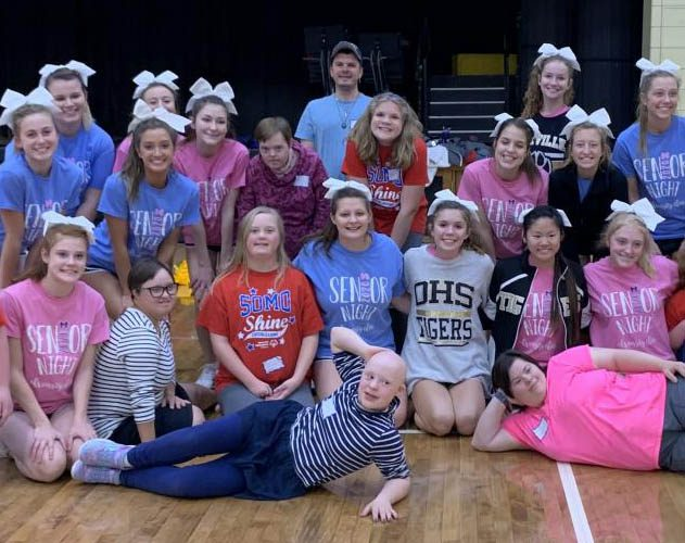 OHS+cheerleaders+and+the+SOMO+Shine+cheer+team+take+a+picture+together+to+remember+the+day.+
