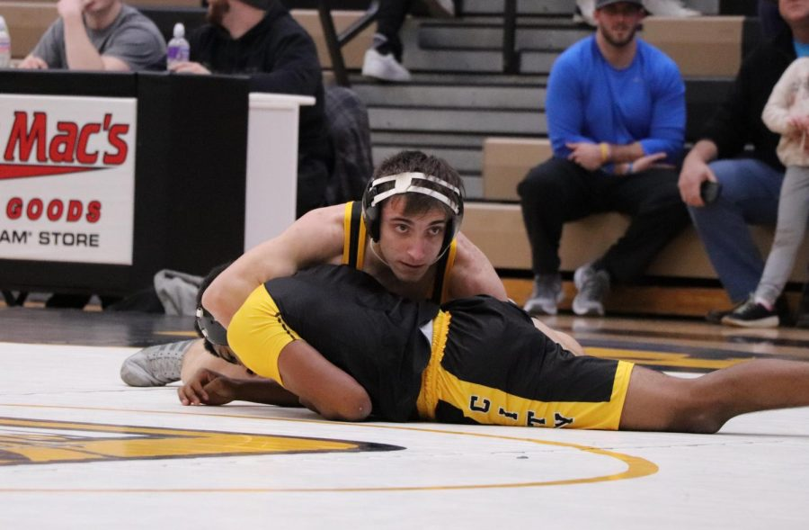 Ibgragim Makhmudov (11) tackles his opponent at a Tri Match against McCluer at OHS on Jan. 5.