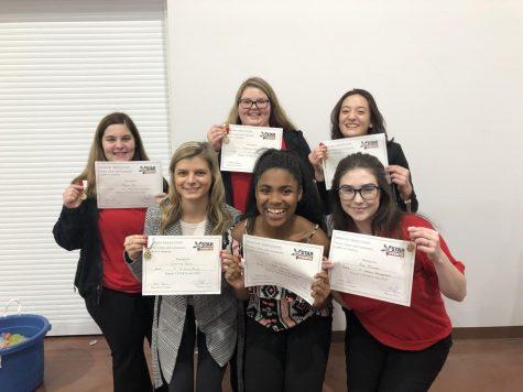 Kayla Jackson (12), Eve Talarski (11), Courtney Doerr (12), Megan Blanchard (11),  Madelynn Turner (12), and Morgan Orr (12) pose for a picture with their gold certificates after receiving news they qualified for state.