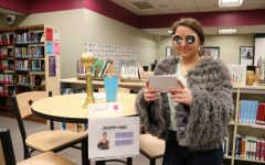 Katelyn Massey (11) poses as Jennifer Lopez for her presentation at the Wax Museum.