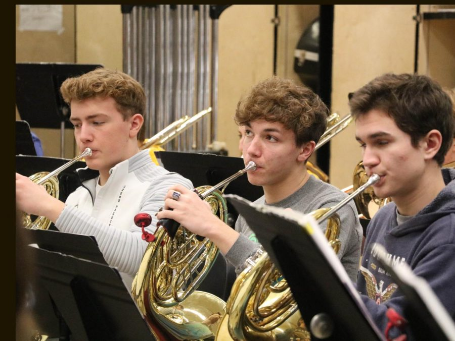 Scott Bellovich (10,) Ben Lanier (11) and Colin Akers (12) prepare for their band trip to Truman. The band will be going Feb. 27-28 for a workshop.