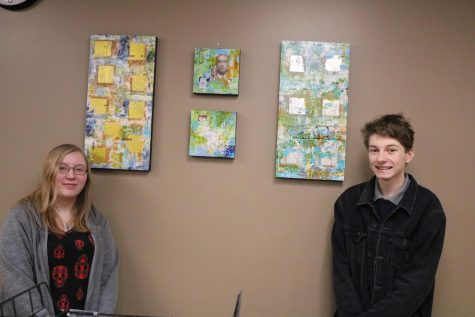 Connor Inman (11) and Abby Degeare (12) pose wit the art pieces they chose for the office.