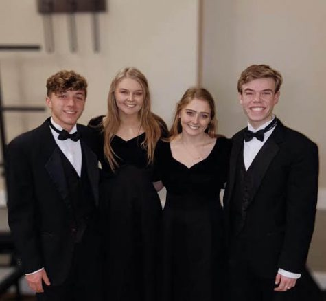 Ben Lanier (11), Riley Hicks (12), Madison Baker (12) and Thomas Schartner (12) pose for a picture after preforming at All-State.