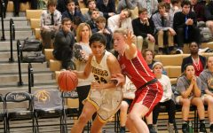 Angela Elguezabal (12) is guarded by a Cor Jesu defensemen as she dribbles the ball closer to the basket.