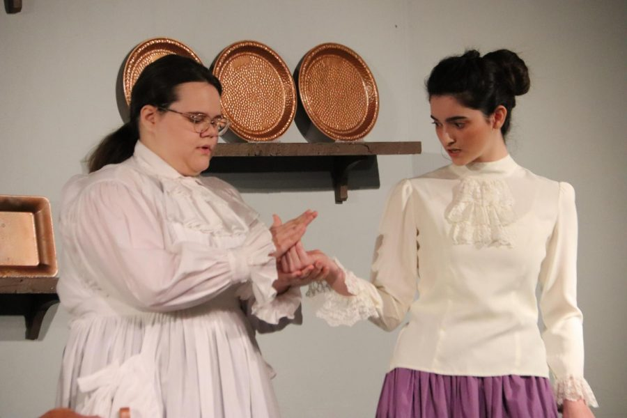 Lejla Suskic (12) and Nora Ovchiyan (12) prepare for the spring play, being preformed in the OHS Drama Department March 4-6