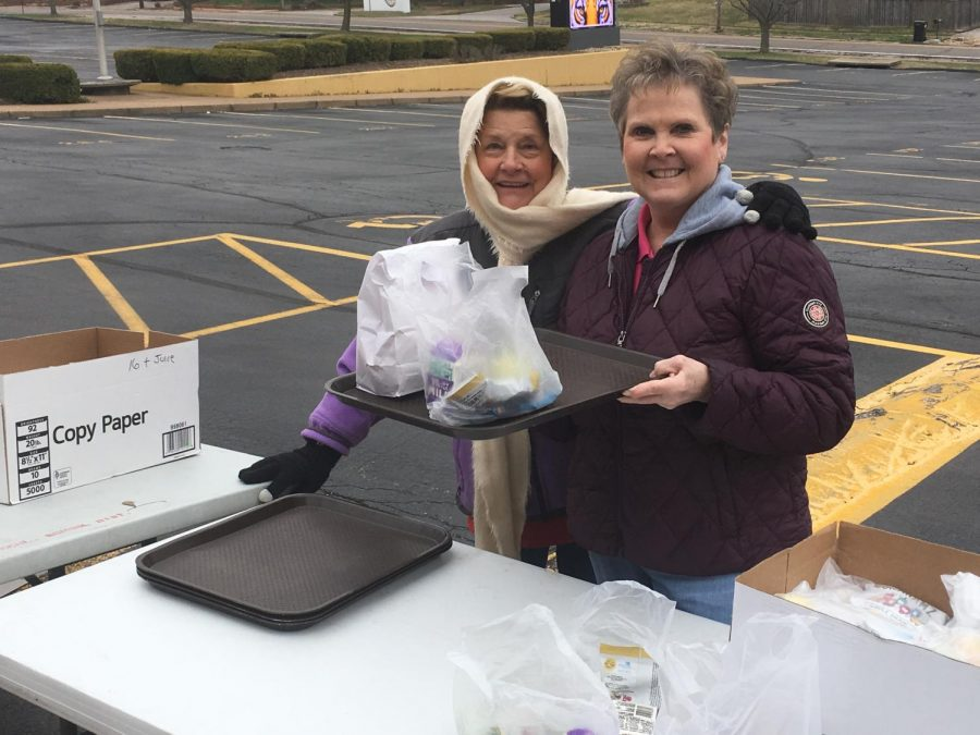 Pam Broz, food manager at Oakville Elementary, and Michelle Kovacich, food manager at Blades Elementary, preparing to distribute meals during the first week of the program at OHS in March.
