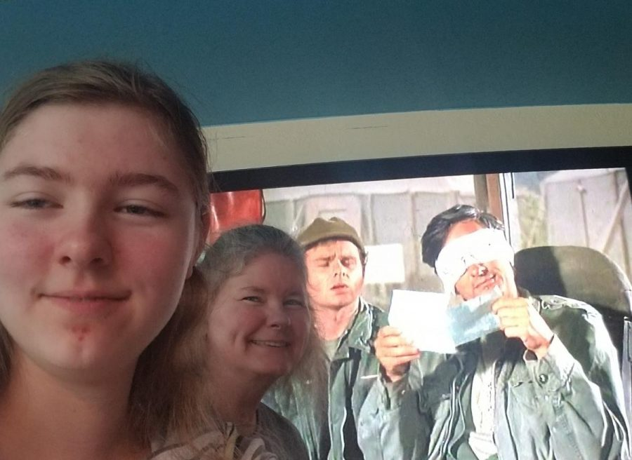 Amber Apetz (11) watching M*A*S*H with her family.