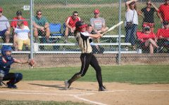 Amanda FitzWilliam (12) finishes her swing after hitting the ball.
