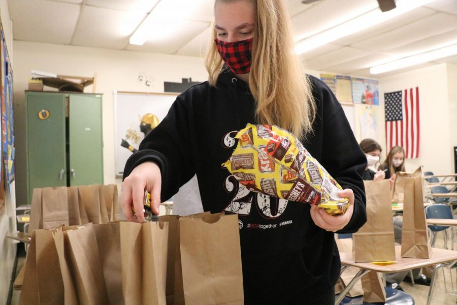 "Sophie Kettenbrink (12) helps NHS make goodie bags for teachers on Oct. 28. ""I'm not too much of an artsy person, but I loved being back and doing something small I feel can make a big impact on lives,"