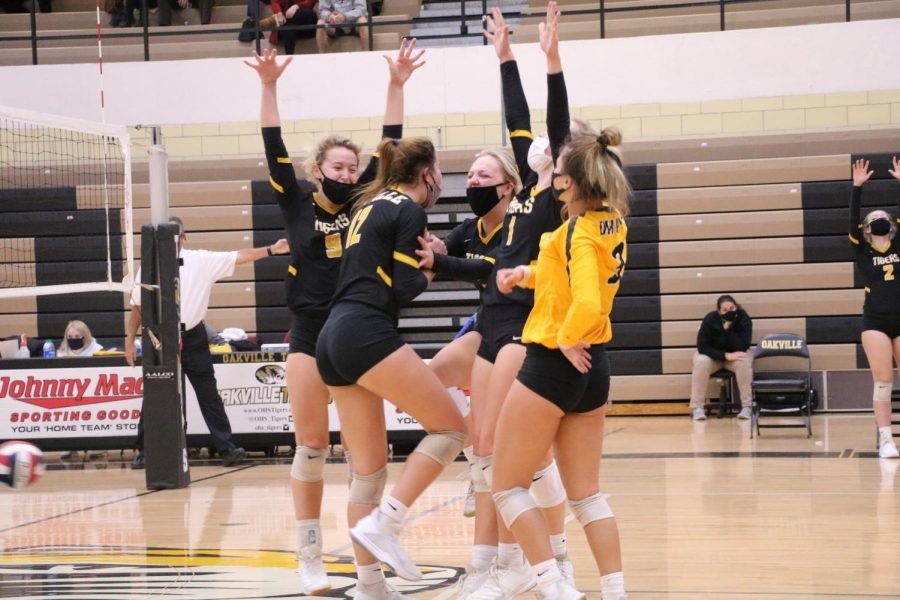 OHS volleyball celebrates winning a point against Mehlville on Oct. 29.