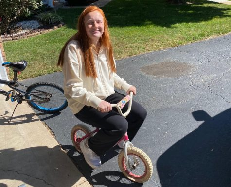 Mackenzie Deutschmann (12) rides her princess bike for the Adventure and Outdoor Pursuits class.