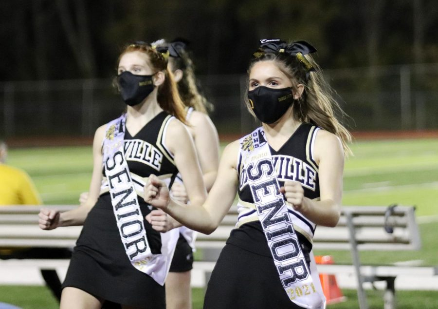 Seniors Vicky Riordan  and Emma Lutker cheer for the football team on their senior night.