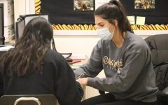 Mrs. Bhambri utilizes intervention time by helping a student with their school work.
